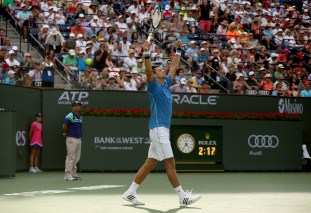 """Novak Djokovic reacts after winning the 2015 BNP Paribas Open Men's Singles Final against Roger Federer in Indian Wells, California on Sunday, March 22, 2015."""