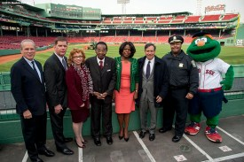 """(From left to right) Boston Red Sox President & CEO Larry Lucchino, Boston Mayor Marty Walsh, North Carolina University Chancellor Debra Saunders-White, Boston Area Church League Chairman Frank Jordan, Florida A&M University President Dr. Elmira Mangum, Boston Red Sox Chairman Tom Werner, Boston Police Chief Williams Gross, and Boston Red Sox mascot Wally the Green Monster pose for a photograph at a press conference announce a Historical Black Colleges Game during a walk through of Fenway Park in Boston, Massachusetts Monday, April 6, 2015."""