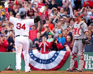 """Boston Red Sox designated hitter David Ortiz reacts after hitting a solo home run during the sixth inning of a home opening game against the Washington Nationals Monday, April 13, 2015 at Fenway Park in Boston, Massachusetts."""