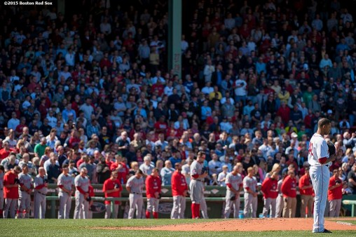 """Boston Red Sox pitcher Anthony Varvaro and members of the Washington Nationals pause for a moment of silence at 2:49 PM recognizing the anniversary of the Boston Marathon bombings during a game between the Boston Red Sox and the Washington Nationals at Fenway Park in Boston, Massachusetts Wednesday, April 15, 2015."""