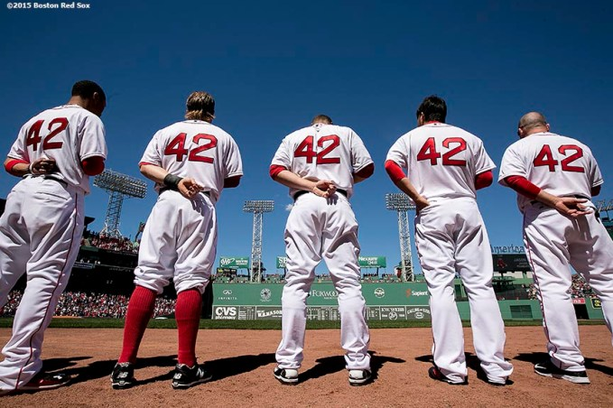 """Members of the Boston Red Sox wear #42 on their jerseys in honor of Jackie Robinson Day as they line up before a game against the Washington Nationals at Fenway Park in Boston, Massachusetts Wednesday, April 15, 2015."""