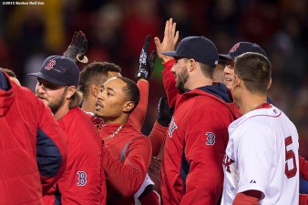 """Boston Red Sox center fielder Mookie Betts reacts after hitting a game winning walk-off single during the ninth inning of a game against the Toronto Blue Jays at Fenway Park in Massachusetts Monday, April 27, 2015."""