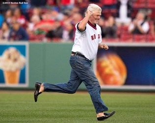 """""""Former Boston Red Sox pitcher Bill Lee runs toward the infield as he is introduced during a 1975 40 year reunion pre-game ceremony before a game between the Boston Red Sox and the Tampa Bay Rays at Fenway Park in Boston, Massachusetts Tuesday, May 5, 2015."""""""