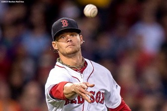 """Boston Red Sox pitcher Clay Buchholz tosses to first base during the fourth inning of a game against the Texas Rangers at Fenway Park in Boston, Massachusetts Thursday, May 21, 2015."""
