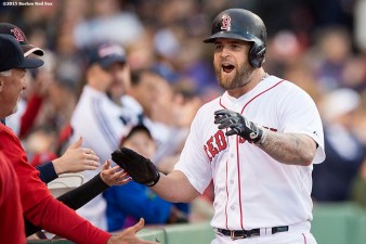 """""""Boston Red Sox first baseman Mike Napoli reacts after hitting a home run during the second inning of a game against the Texas Rangers at Fenway Park in Boston, Massachusetts Saturday, May 23, 2015."""""""