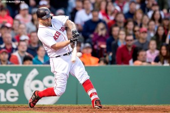 """Boston Red Sox first baseman Mike Napoli hits a home run during the second inning of a game against the Texas Rangers at Fenway Park in Boston, Massachusetts Saturday, May 23, 2015."""