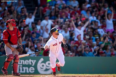 """Boston Red Sox first baseman Mike Napoli hits an RBI double during the eighth inning of a game against the Los Angeles Angels of Anaheim at Fenway Park in Boston, Massachusetts Sunday, May 24, 2015."""
