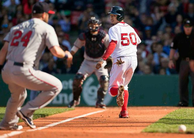 """""""Boston Red Sox center fielder Mookie Betts runs toward home plate during a game against the Minnesota Twins at Fenway Park in Boston, Massachusetts Thursday, June 4, 2015."""""""