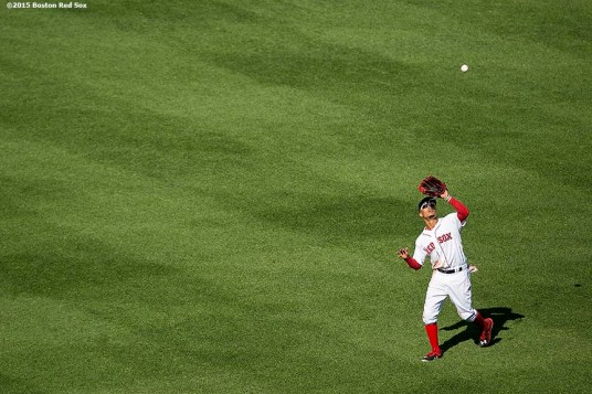 """""""Boston Red Sox center fielder Mookie Betts catches a fly ball during a game against the Minnesota Twins at Fenway Park in Boston, Massachusetts Thursday, June 4, 2015."""""""