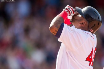 """Boston Red Sox third baseman Pablo Sandoval reacts after hitting an RBI single during the eighth inning of a game against the Oakland Athletics at Fenway Park in Boston, Massachusetts Sunday, June 7, 2015."""