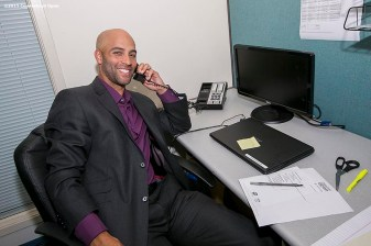 """Former ATP World Tour star and Connecticut Open Legends Event Participant James Blake makes calls to ticket holders during a press conference at the Connecticut Tennis Center to announce the new Connecticut Open 50/50 Project and the renewal of United Technologies sponsorship of the tournament through the 2017 in New Haven, Connecticut Tuesday, June 9, 2015."""