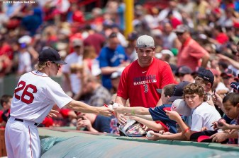 """First baseman Brock Holt signs autographs before a game between the Boston Red Sox and the Toronto Blue Jays at Fenway Park in Boston, Massachusetts Saturday, June 13, 2015."""