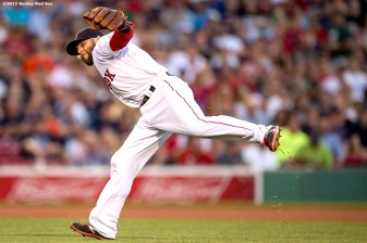 """Boston Red Sox second baseman Dustin Pedroia throws to first base during the fourth inning of a game against the Baltimore Orioles at Fenway Park in Boston, Massachusetts Wednesday, June 24, 2015."""