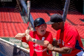 """""""Boston Red Sox hitting coach Chili Davis gives pointers to a Veteran during a CVS Hitting Clinic at Fenway Park in Boston, Massachusetts Friday, July 3, 2015."""""""