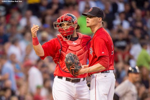 """Boston Red Sox pitcher Clay Buchholz and catcher Sandy Leon signal to exit the game during the fourth inning of a game against the New York Yankees at Fenway Park in Boston, Massachusetts Friday, July 10, 2015."""