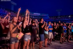 """Fans cheer during a Foo Fighters concert at Fenway Park in Boston, Massachusetts Sunday, July 19, 2015."""