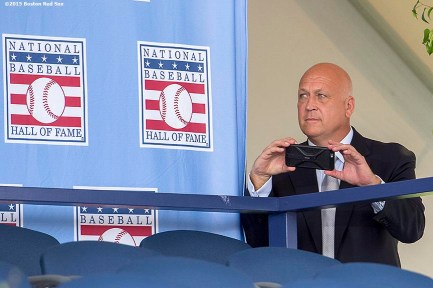 """Hall of Famer Cal Ripken Jr. peeks out from backstage to take a photograph at the plaque ceremony during the 2015 Hall of Fame weekend at the National Baseball Hall of Fame in Cooperstown, New York Sunday, July 26, 2015."""