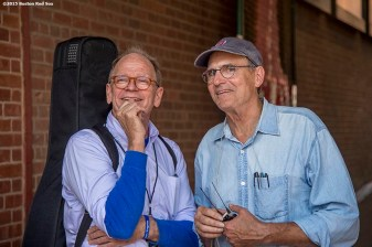 """""""Singer James Taylor looks on with his brother Livingston Taylor before a concert at Fenway Park in Boston, Massachusetts Thursday, August 6, 2015."""""""