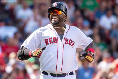 """Boston Red Sox designated hitter David Ortiz reacts during the third inning of a game against the Seattle Mariners at Fenway Park in Boston, Massachusetts Sunday, August 16, 2015."""