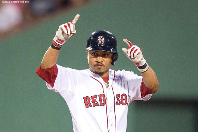 """""""Boston Red Sox center fielder Mookie Betts reacts after hitting a bases clearing RBI double during the second inning of a game against the Cleveland Indians at Fenway Park in Boston, Massachusetts Tuesday, August 18, 2015."""""""