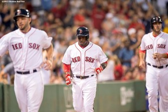 """""""Boston Red Sox catcher Blake Swihart, right fielder Rusney Castillo, and first baseman Travis Shaw run toward the dugout after scoring on a bases clearing double by center fielder Mookie Betts during the second inning of a game against the Cleveland Indians at Fenway Park in Boston, Massachusetts Tuesday, August 18, 2015."""""""