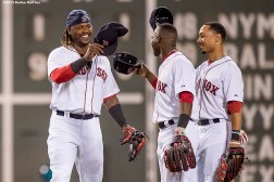 """""""Boston Red Sox left fielder Hanley Ramirez, center fielder Mookie Betts, and right fielder Rusney Castillo high five after defeating the Cleveland Indians at Fenway Park in Boston, Massachusetts Tuesday, August 18, 2015."""""""