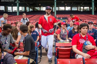 """""""Boston Red Sox second baseman Dustin Pedroia signs autographs during a Jimmy Fund meet and greet at Fenway Park in Boston, Massachusetts Saturday, August 22, 2015."""""""