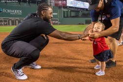 """Boston Red Sox outfielder Jackie Bradley Jr. high fives kids as they run the bases following a game against the New York Yankees at Fenway Park, Massachusetts, Wednesday, September 2, 2015."""