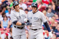"""New York Yankees right fielder Carlos Beltran and designated hitter Alex Rodriguez react after scoring during the third inning of a game against the Boston Red Sox at Fenway Park in Boston, Massachusetts Wednesday, September 2, 2015."""