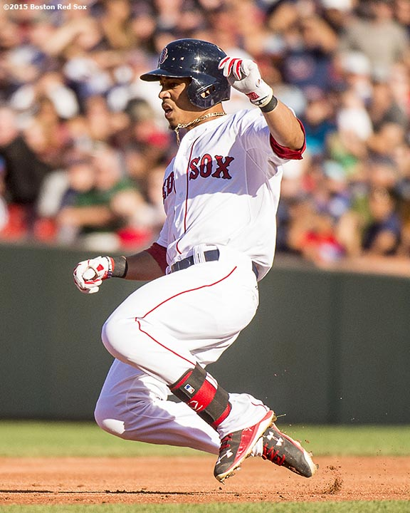 """""""Boston Red Sox center fielder Mookie Betts slides into second base after hitting a double during the third inning of a game against the Philadelphia Phillies at Fenway Park in Boston, Massachusetts Saturday, September 5, 2015."""""""