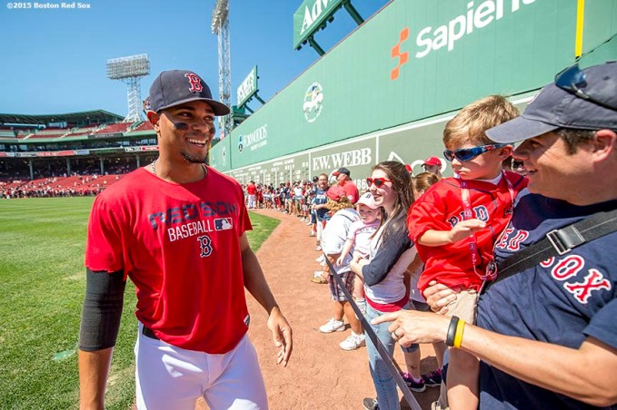 """Boston Red Sox shortstop Xander Bogaerts greets fans during on-field photo day before game against the Philadelphia Phillies at Fenway Park in Boston, Massachusetts Saturday, September 6, 2015."""