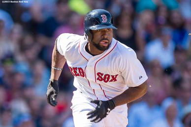 """Boston Red Sox left fielder Jackie Bradley Jr. rounds first base after hitting an RBI triple during the second inning of a game against the Philadelphia Phillies at Fenway Park in Boston, Massachusetts Sunday, September 6, 2015."""