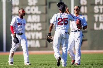 """Boston Red Sox left fielder Rusney Castillo, center fielder Mookie Betts and right fielder Jackie Bradley Jr. react after defeating the Philadelphia Phillies at Fenway Park in Boston, Massachusetts Sunday, September 6, 2015."""