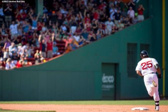"""Boston Red Sox right fielder Jackie Bradley Jr. rounds second base after hitting a two run home run during the sixth inning of a game against the Toronto Blue Jays at Fenway Park in Boston, Massachusetts Monday, September 7, 2015."""