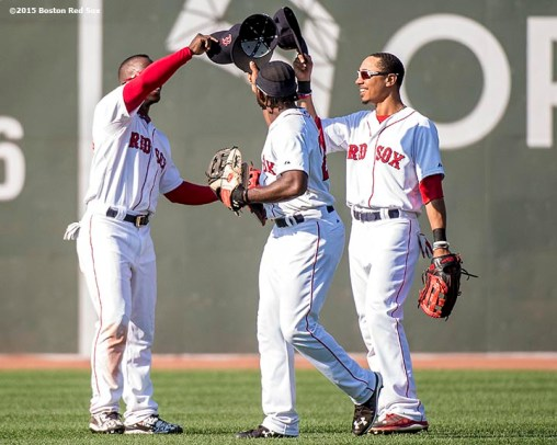 """Boston Red Sox left fielder Rusney Castillo, center fielder Mookie Betts and right fielder Jackie Bradley Jr. react after defeating the Toronto Blue Jays at Fenway Park in Boston, Massachusetts Monday, September 7, 2015."""