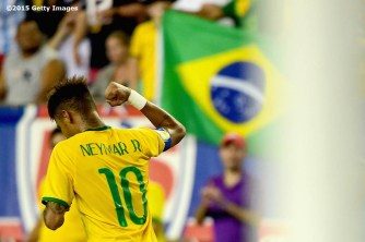 FOXBORO, MA - SEPTEMBER 08: Neymar #10 of Brazil reacts after scoring a goal during an international friendly against the United States at Gillette Stadium on September 8, 2015 in Foxboro, Massachusetts. (Photo by Billie Weiss/Getty Images)