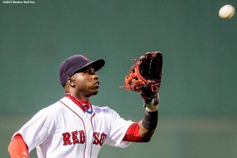 """Boston Red Sox left fielder Rusney Castillo catches a fly ball during the first inning of a game against the Toronto Blue Jays at Fenway Park in Boston, Massachusetts Monday, September 9, 2015."""