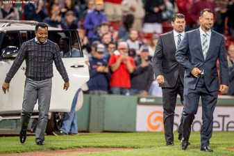 """Former Bosotn Red Sox pitcher Pedro Martinez, catcher Jason Varitek, and pitcher Tim Wakefield exit a car as they greet Boston Red Sox designated hitter David Ortiz during a ceremony recognizing his 500th career home run before a game against the Tampa Bay Rays at Fenway Park in Boston, Massachusetts Monday, September 21, 2015."""