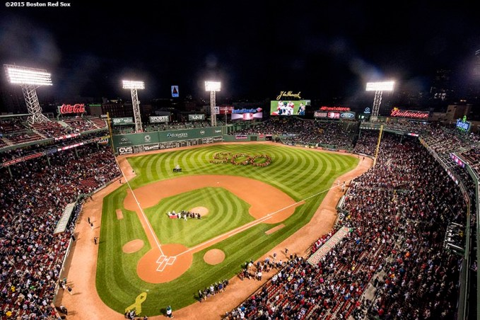 """Kids form a 500 formation in the outfield during a ceremony recognizing Boston Red Sox designated hitter David Ortiz' 500th career home run before a game against the Tampa Bay Rays at Fenway Park in Boston, Massachusetts Monday, September 21, 2015."""