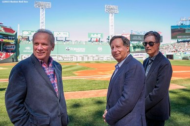 """Boston Red Sox President & CEO Larry Lucchino, Chairman Tom Werner, and Principal Owner John Henry look on during a tribute ceremony for Larry Lucchino before a game between the Boston Red Sox and the Baltimore Orioles at Fenway Park in Boston, Massachusetts Sunday, September 27, 2015."""