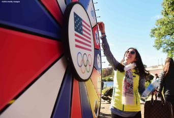 BOSTON, MA - OCTOBER 17: A fan spins a prize wheel during a Road to Rio Tour presented by Liberty Mutual Insurance event on October 17, 2015 at the Head of the Charles Regatta in Boston, Massachusetts. (Photo by Billie Weiss/Getty Images for the USOC)