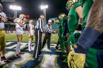 """The coin toss is held during the Shamrock Series Football at Fenway game between Notre Dame and Boston College at Fenway Park in Boston, Massachusetts Saturday, November 21, 2015."""
