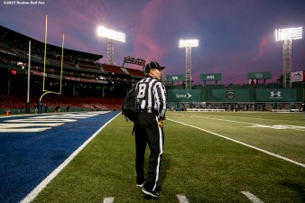 """A referee arrives on field during the Shamrock Series Football at Fenway game between Notre Dame and Boston College at Fenway Park in Boston, Massachusetts Saturday, November 21, 2015."""