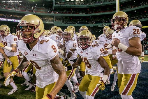 """Members of Boston College huddle together during the Shamrock Series Football at Fenway game against Notre Dame at Fenway Park in Boston, Massachusetts Saturday, November 21, 2015."""