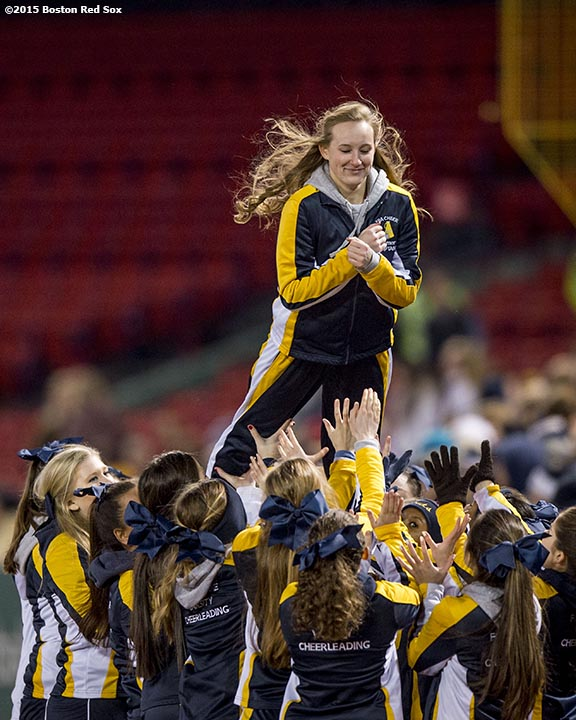 """A cheerleader is lifted in the air during a high school football game between Xaverian Brothers High School and St. John's Preparatory School at Fenway Park in Boston, Massachusetts Wednesday, November 25, 2015."""