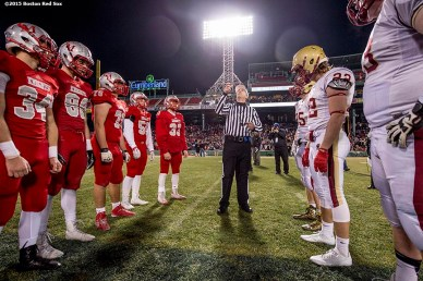 """A coin toss before a high school football game between Boston College High School and Catholic Memorial High School at Fenway Park in Boston, Massachusetts Wednesday, November 25, 2015."""