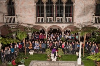 """Museum Director Anne Hawley poses with staff for a group photo in the courtyard during a staff party at the Isabella Stewart Gardner Museum in Boston, Massachusetts Wednesday, December 2, 2015."""