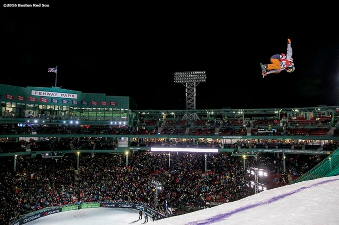 """A snowboarder drops into the ramp during the Polartec Big Air at Fenway ski and snowboard competition at Fenway Park in Boston, Massachusetts Thursday, February 11, 2016."""