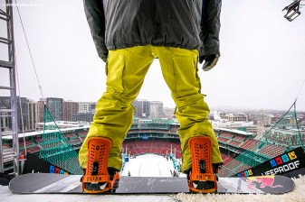 """A snowboarder prepares to drop into the ramp during the Polartec Big Air at Fenway ski and snowboard competition at Fenway Park in Boston, Massachusetts Thursday, February 11, 2016."""
