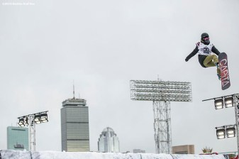 """A snowboarder jumps off the ramp during the Polartec Big Air at Fenway ski and snowboard competition at Fenway Park in Boston, Massachusetts Thursday, February 11, 2016."""